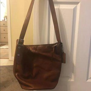 Brown leather Coach hobo bag.